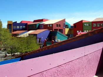 A set of very colorful rooftops and walls on colorful buildings in downtown Tucson, Arizona.