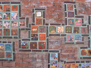 An assortment of artistic wall tiles on the side of a building in downtown Tucson, Arizona.
